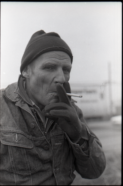 Portrait of unidentified man in stocking cap smoking a cigarette (New York, N.Y.), linking to the digital object