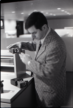 Airport employee examining equipment, JFK airport (New York, N.Y.), linking to the digital object