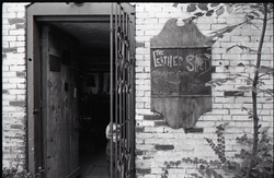 Entrance to the Leather Shed (Amherst, Mass.), linking to the digital object