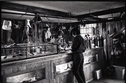 Don Muller behind the counter with a customer, the Leather Shed (Amherst, Mass.), linking to the digital object