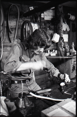 Don Muller working at his bench, the Leather Shed (Amherst, Mass.), linking to the digital object