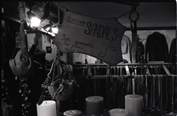Sign advertising sandles for sale above candle display, the Leather Shed (Amherst, Mass.), linking to the digital object