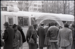 By-standers milling outside Free Spirit Press bus near Central Park (New York, N.Y.), linking to the digital object