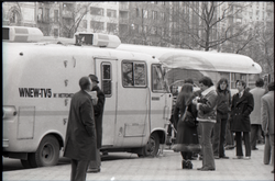 People milling alongside the Channel 5 news van (New York, N.Y.), linking to the digital object