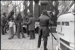 Commune members being interviewed by Channel 5 news: Steve Wilhelm, James Baker and Richard Safft in background (l. to r.) (New York, N.Y.), linking to the digital object