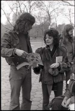 Steve Wilhelm and reporter looking at copies of Free Spirit Press magazine during interview by Channel 5 news (New York, N.Y.), linking to the digital object