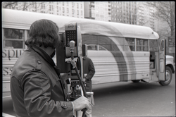 Cameraman taking shots of the bus during interview by Channel 5 news (New York, N.Y.), linking to the digital object