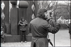 Cameraman preparing to film Richard Safft during interview by Channel 5 news (New York, N.Y.), linking to the digital object