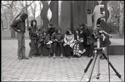 Camera set up to film Richard Safft (reading) and other commune members during interview by Channel 5 news (New York, N.Y.), linking to the digital object