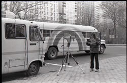Richard Safft reading copy of Free Spirit Press, standing by camera and Free Spirit Press bus, during interview by Channel 5 news (New York, N.Y.), linking to the digital object