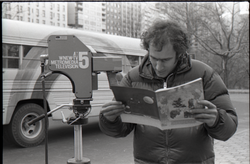 Richard Safft reading copy of Free Spirit Press magazine during interview by Channel 5 news (New York, N.Y.), linking to the digital object