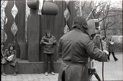 Richard Safft reading copy of Free Spirit Press magazine in front of sculpture during interview by Channel 5 news (New York, N.Y.), linking to the digital object