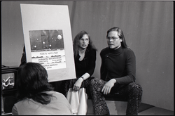 James Baker and Anne Baker seated on stage with placard containing credits for the WGBY program Open Door (Springfield, Mass.), linking to the digital object