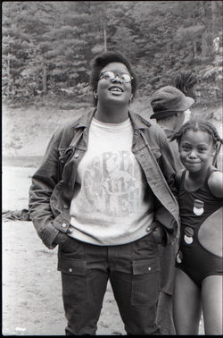 Woman (possibly at a summer camp) wearing a Spirit in Flesh t-shirt, linking to the digital object