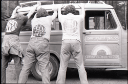 Three members of the Brotherhood of the Spirit Community feigning arrest, wearing Spirit in Flesh t-shirts and leaning against the Free Spirit Press van (Greenfield, Mass.), linking to the digital object