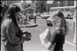 Crew distributing Free Spirit Press magazine: woman purchasing a copy (New York, N.Y.), linking to the digital object