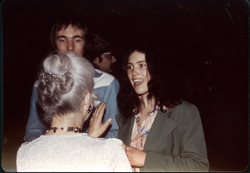 Andy Baer and Patti Smith conversing with Roberta Meyer (?) (Turners Falls, Mass.), linking to the digital object