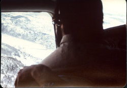 View over the shoulder of the pilot from the Commune's Cessna in flight (Turners Falls, Mass.), linking to the digital object