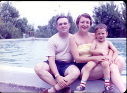 Couple and child, seated by a swimming pool: apparently a reprint of an older photograph (Turners Falls, Mass.), linking to the digital object