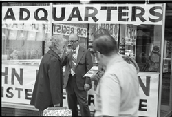 Free Spirit Press crew member distributing the magazine in front of headquarters for John O'Brien, candidate for register of probate (Springfield, Mass.), linking to the digital object