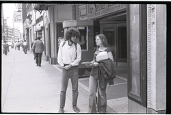 Free Spirit Press crew member selling the magazine in front of a movie theater (Springfield, Mass.), linking to the digital object