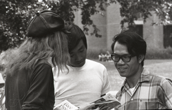 Free Spirit Press crew member showing magazine to UMass Amherst students (Amherst, Mass.), linking to the digital object