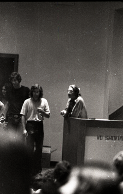 UMass Amherst students in a lecture hall (Amherst, Mass.), linking to the digital object