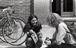 Free Spirit Press crew distributing the magazine to a young woman outside the UMass Amherst Student Union (Amherst, Mass.), linking to the digital object