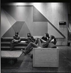 Students sitting in the basement of the UMass Amherst Campus Center (Amherst, Mass.), linking to the digital object