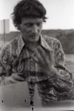 Mike Scanlon in paisley shirt looking at his hand (Warwick, Mass.), linking to the digital object