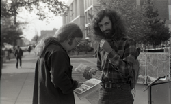 Free Spirit Press crew member distributing copies of the magazine, possibly in Springfield (Springfield, Mass.), linking to the digital object