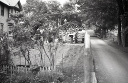 View down the road, past a Brotherhood of the Spirit commune garden (Warwick, Mass.), linking to the digital object