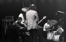Miles Davis in performance: Cedric Lawson (keyboard), Reggie Lucas (guitar), Dave Liebman (back to camera), Al Foster (drums) (New York, N.Y.), linking to the digital object