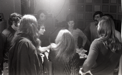 Commune members preparing for interview on the WGBY program Catch 44 (public access television show): Bruce Geisler and Anne and James Baker are in front right, backs to camera (Springfield, Mass.), linking to the digital object