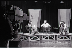 Commune members at the WGBY Catch 44 (public access television) interview: Anne Baker, James Baker, and Bruce Geisler on stage (Springfield, Mass.), linking to the digital object