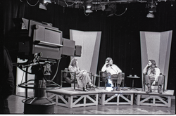 Commune members at the WGBY Catch 44 (open access television) interview: Anne Baker, James Baker, and Bruce Geisler on stage (Springfield, Mass.), linking to the digital object