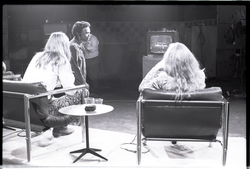 Commune members at the WGBY Catch 44 (public access television) interview: shot from the rear of Anne and Jim Baker on stage, looking at monitor (Springfield, Mass.), linking to the digital object