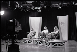 Commune members at the WGBY Catch 44 (public access television) interview: Anne Baker, Jim Baker, and Bruce Geisler on stage (Springfield, Mass.), linking to the digital object