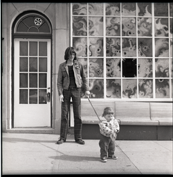 Mark Holland with daughter Lamia on a leash (Springfield, Mass.), linking to the digital object