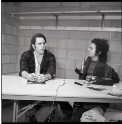 Bob Weir sitting at table with Mitch Seiser (l. to r.) (Springfield, Mass.), linking to the digital object