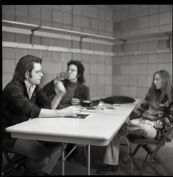 Bob Weir sitting at table with Mitch Seiser and Anne Baker (l. to r.) (Springfield, Mass.), linking to the digital object