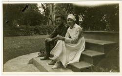 Yeomans and unidentified nurse, seated on steps, linking to the digital object