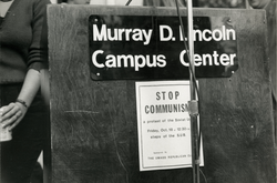 "Handbill posted on podium reading ""Stop Communism a protest of the Soviet Union Sponsored by the UMass Republican Club"", linking to the digital object"