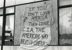 "Banners hanging on building (possibly Beta Kappa Phi frat) reading ""If you don't love American then leave!"" and ""CIA the American way, Beat it liberals"", linking to the digital object"