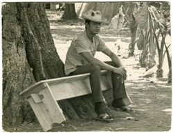 Postcard of Renato, Cuban jefe of work brigade, seated on bench (postcard from Sandra Rice inviting Lillydahl to festival on Cambridge Common)