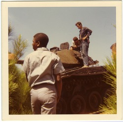 Playa Giron (Bay of Pigs): Brigade members and others atop inactive tank