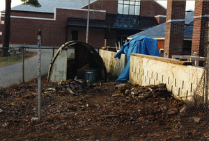 quonset hut, cinder block wall and brick chimney-like kilns are all that remains of the destruction of the back room of Munson Annex and the fenced-in area