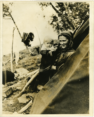 Lapp mother with her baby, in the tent (Norway), linking to the digital object