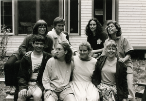 Group posed in front of a house, with Grace Gershuny (top left)