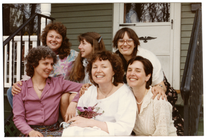 Group of women seated on a front steps of a house (Grace Gershuny, back row, far right)
